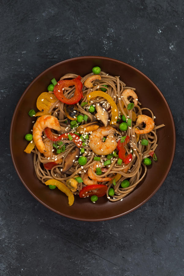 Free Buckwheat Noodles With Seafood In A Bowl On Dark Background Royalty Free Stock Image - 75935936