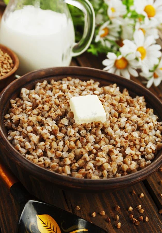 Buckwheat porridge with butter stock photos