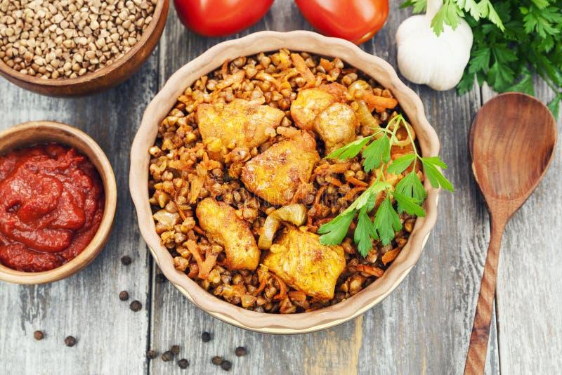 Buckwheat porridge with meat and tomato sauce stock photos
