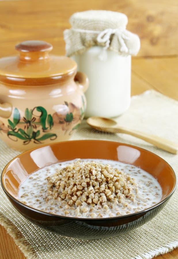Buckwheat porridge with milk stock photos