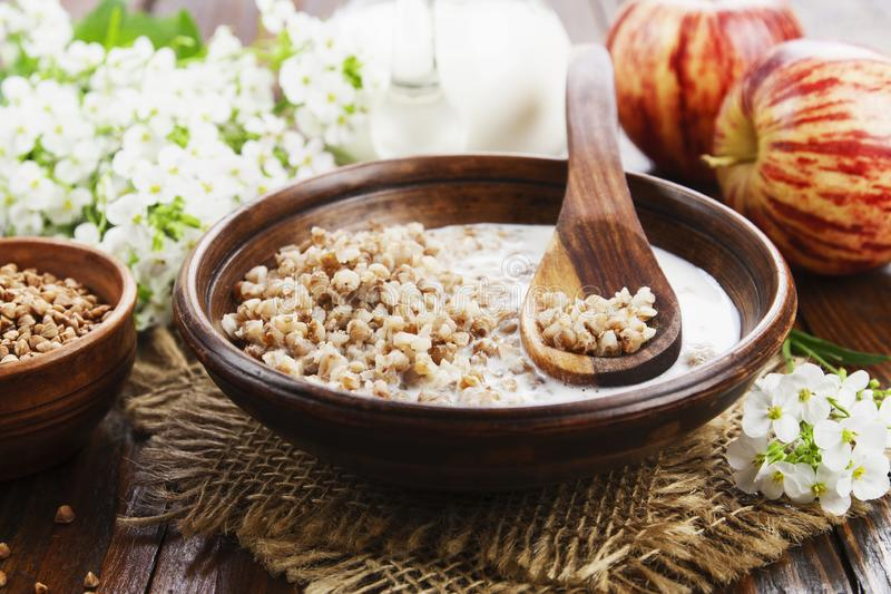 Buckwheat porridge with milk i stock images