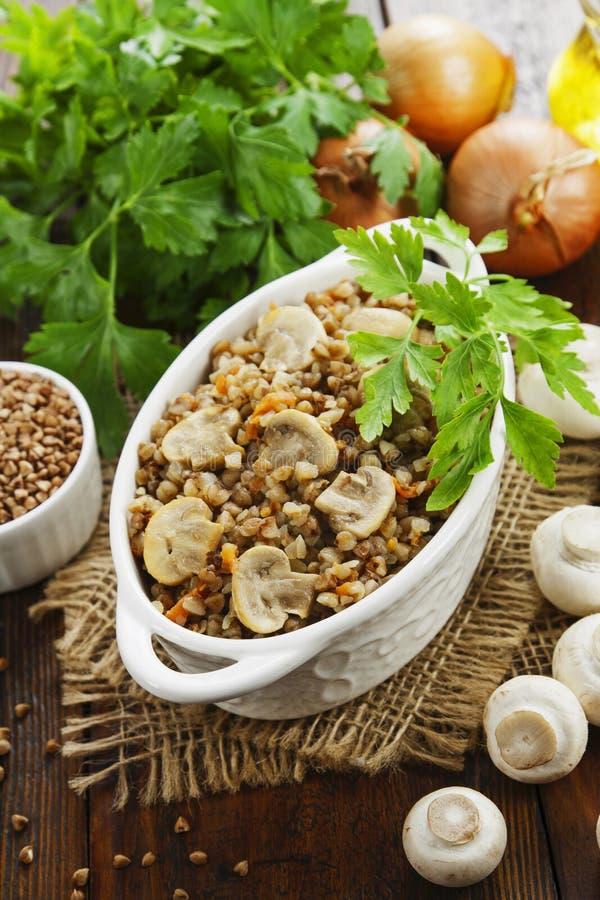 Buckwheat porridge with mushrooms royalty free stock images