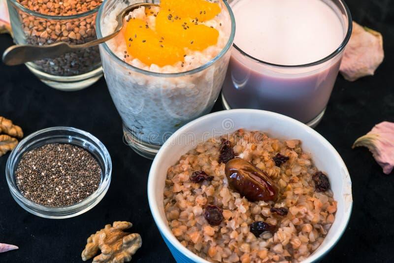 Buckwheat porridge,tapioca pudding,milk and seeds. stock images
