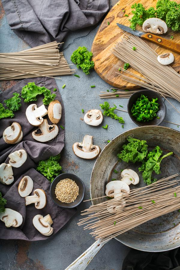 Buckwheat soba noodles soup ingredients for asian chinese japanese korean vietnamese food. Top view flat lay kitchen cooking stock images