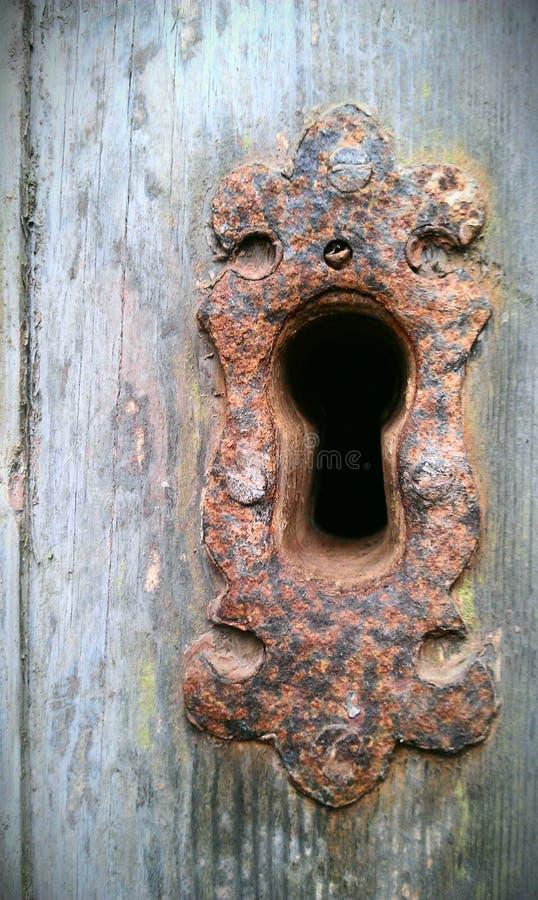 Buco della serratura arrugginito fotografie stock