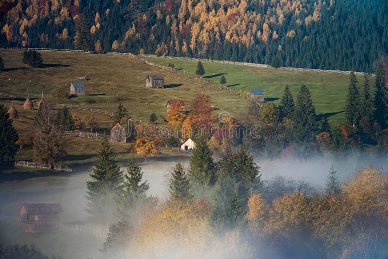 Bucovina autumn sunrise landscape in Romania with mist and mountains royalty free stock image