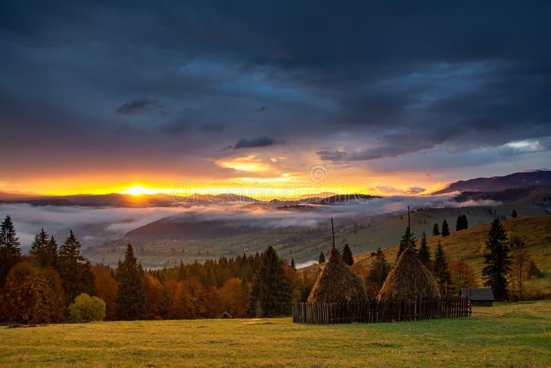 Bucovina autumn sunrise landscape in Romania with mist and mountains. Bucovina autumn landscape in Romania with mist and mountains after rainy day royalty free stock photo