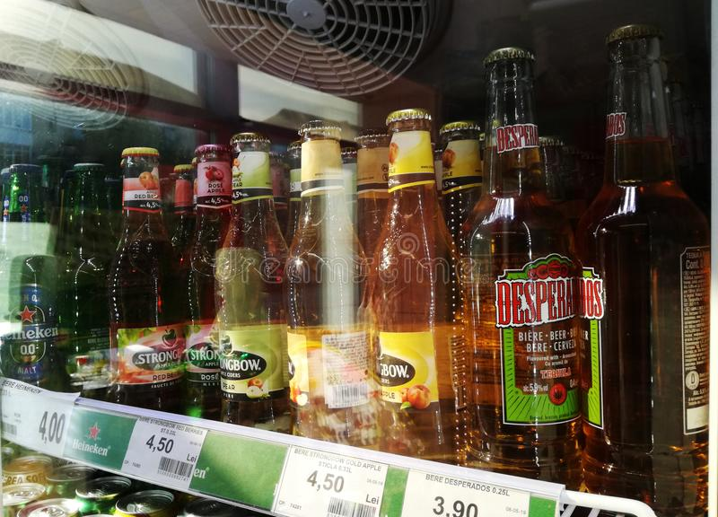 Bucuresti, Romania. August, 10, 2019-   photograph taken through the window at `Strongbow` cider bottles and `Desperados` beer royalty free stock photography