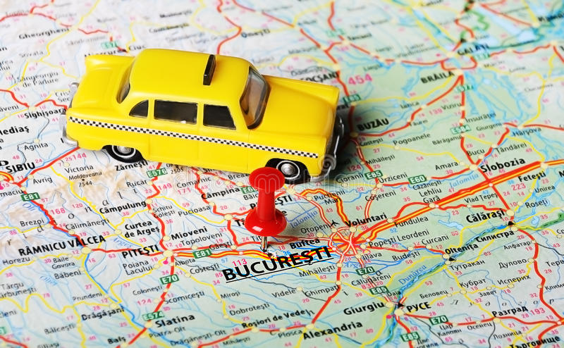 Bucuresti ,Romania map taxi. Close up of Bucuresti ,Romania mapand taxi car toy - Travel concept royalty free stock photos