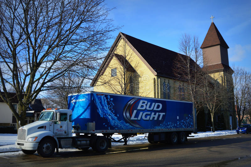 Bud Light Beer Truck Parked by a Church. A Bud Light beer delivery truck parked by a Catholic Church in Lake Geneva, Wisconsin stock images
