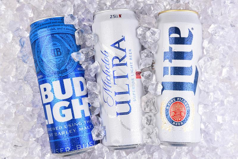 Bud Light, Michelob Ultra, Miller Lite. IRVINE, CALIFORNIA - MARCH 29, 2018: Three of the most popular Light beers in a bed of ice. King cans of Bud Light royalty free stock photos