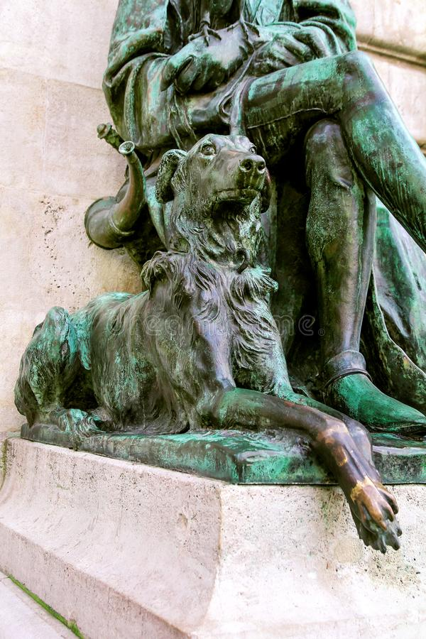 Buda Castle Bronze Sculptures with Man, Falcon and Dog. In Budapest, Hungary royalty free stock photo
