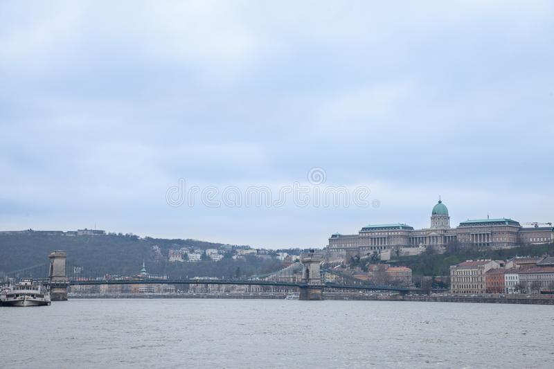 Buda Castle seen from Pest with the Danube and Szechenyi Chain Bridge in front. royalty free stock photos