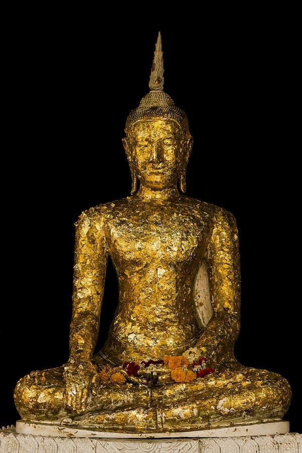 Buda de oro que se sienta en el substituto fotografía de archivo libre de regalías