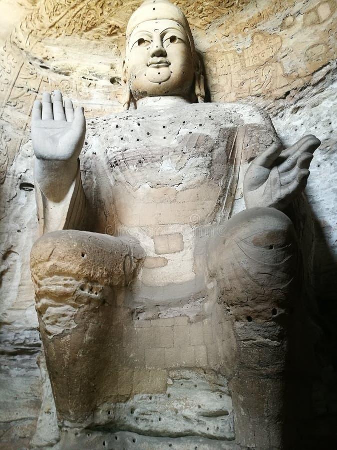 Buda de piedra DA Tong Grottos fotos de archivo