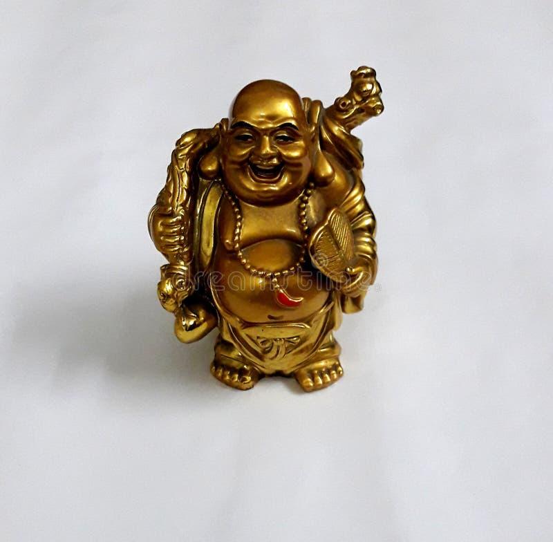 Buda de riso dourada com saco e fã do dinheiro fotografia de stock