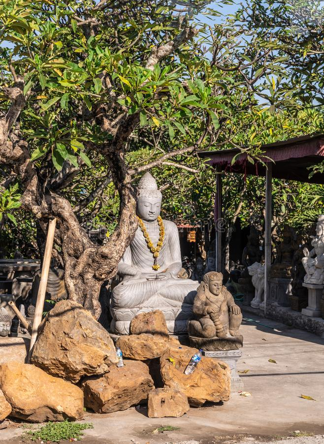 Buda en la tienda de la estatua en Denpasar, Bali Indonesia imagenes de archivo