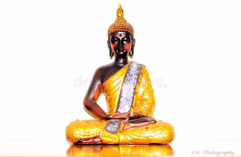 Buda High Key. High-Key Buda in a table with a reflection stock photography