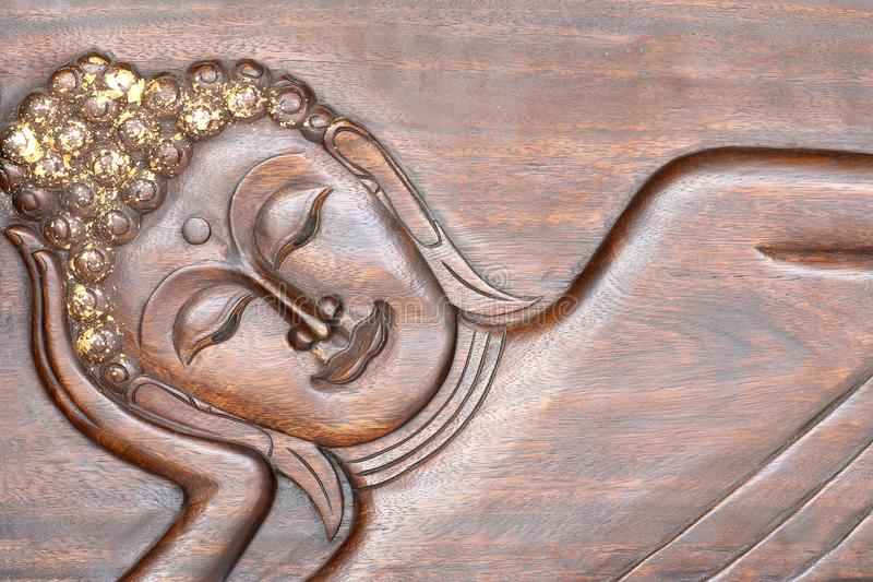 Buda que talla en el fondo de madera de la textura imagen de archivo libre de regalías