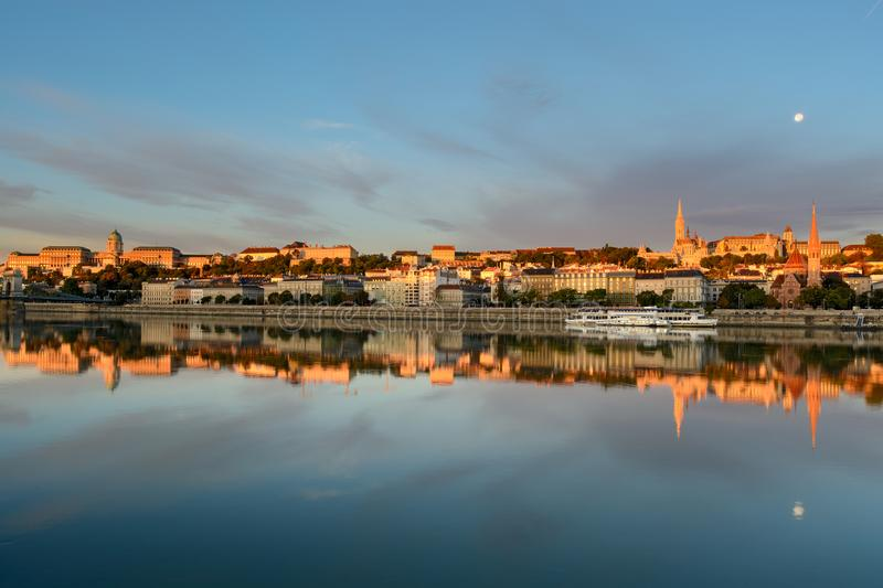 Buda side of Budapest city reflecting in still water of Danube river. Under the moon royalty free stock photography