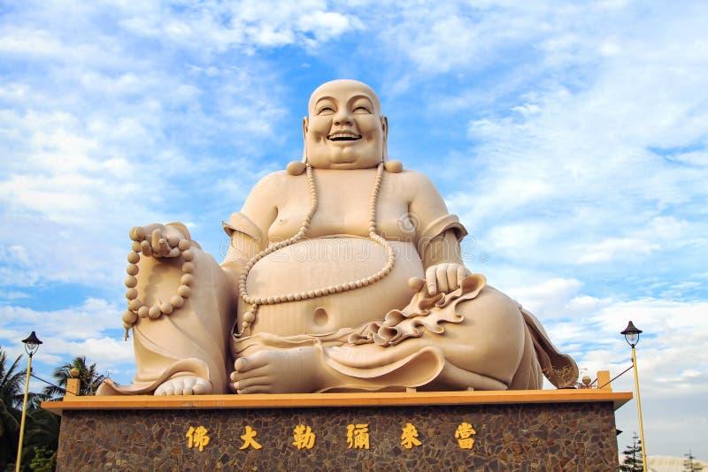 Buda sonriente que se sienta foto de archivo