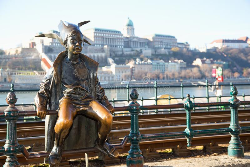 Budapest Attractions. Little Princess perched by the tram rails on the Pest, with Buda Castle in background, landmark of Hungary c stock photography