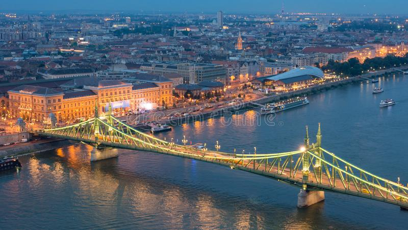 Budapest city at blue hour with illuminated Liberty bridge on Danube River, picturesque evening cityscape. stock image
