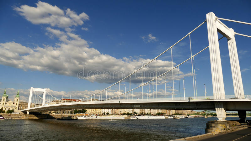 Budapest with the Elisabeth Bridge. Elisabeth Bridge over river Danube in Budapest with cloudy sky stock images
