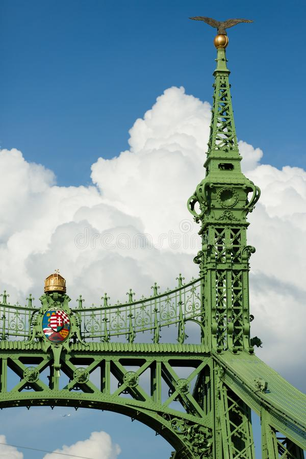 Free Budapest Famous Freedom Bridge Detail, Green Painted Iron Base, Crown And Shield With Crest, And Golden Apple With Bird Royalty Free Stock Images - 125696559