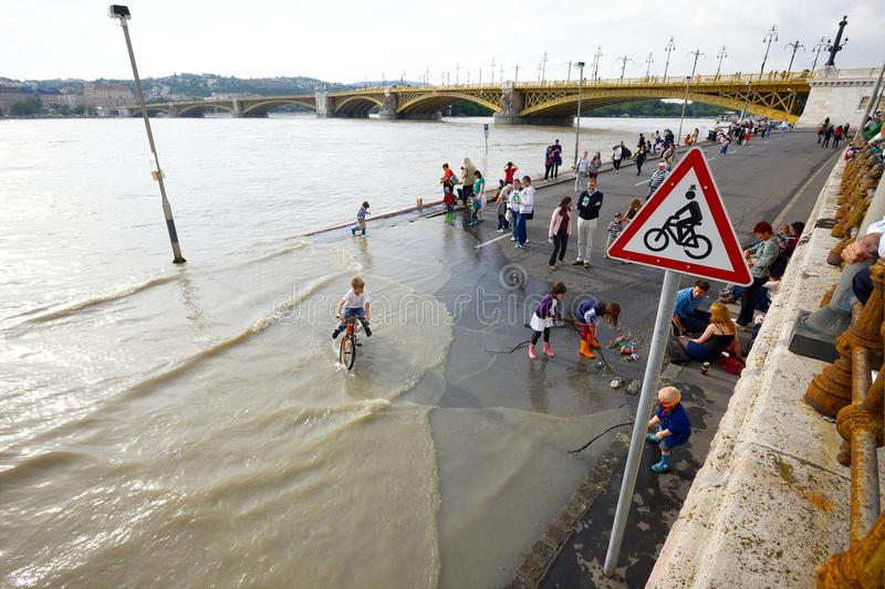 Budapest Flood. BUDAPEST, HUNGARY - JUNE 6: People at the flooding river Danube, June 6th 2013. Record breaking water level is expected in a few days stock image