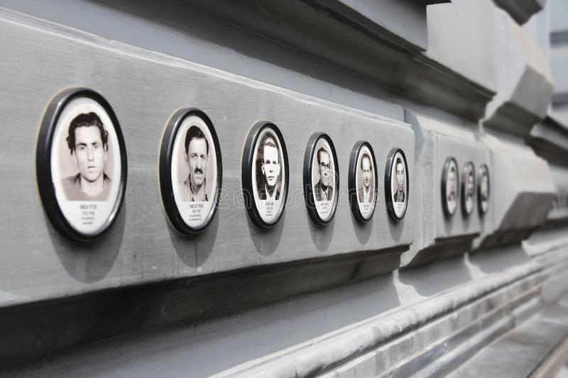 Budapest House of Terror. BUDAPEST, HUNGARY - JUNE 19, 2014: Photos of victims of fascist and communist regimes outside House of Terror, Budapest. 3,000 stock photography