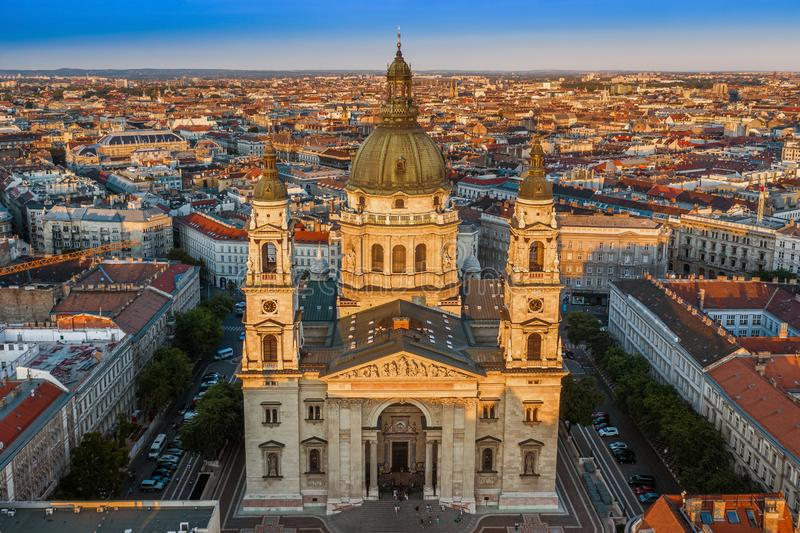 Budapest, Hungary - Aerial drone view of the beautiful St. Stephen`s Basilica at sunset with warm summer afternoon lights. And clear blue sky royalty free stock photography