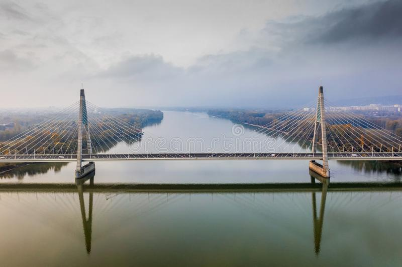 Budapest, Hungary - Aerial drone view of Megyeri Bridge, the biggest bridge of Budapest on a cloudy autumn. Morning royalty free stock photos