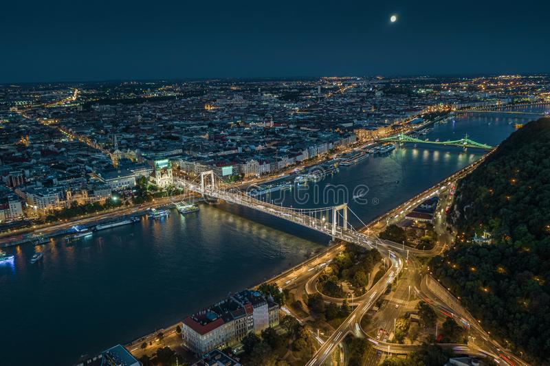 Budapest, Hungary - Aerial drone view of Budapest by night with illuminated Elisabeth and Liberty bridges, River Danube. And Gellert Hill at dusk royalty free stock photos