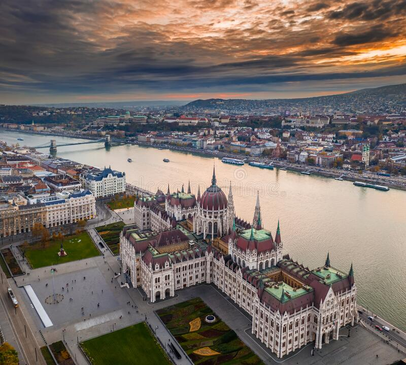 Budapest, Hungary - Aerial panoramic drone view of the Hungarian Parliament building on a november afternoon. With an amazing dramatic colorful gold sunset and stock photo