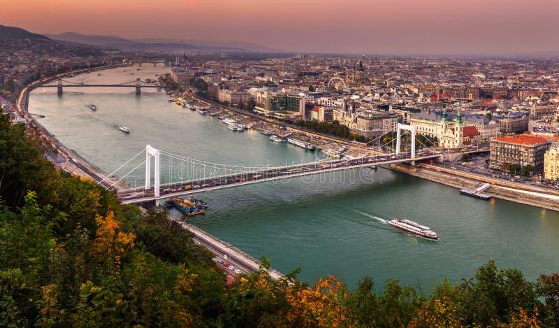 Budapest, Hungary - Aerial panoramic skyline of Budapest at sunset with Elisabeth Bridge Erzsebet Hid. Szechenyi Chain Bridge, Parliament and sightseeing boat royalty free stock photography