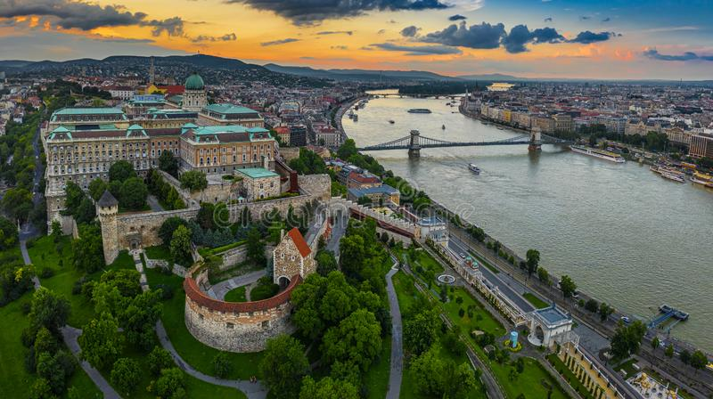 Budapest, Hungary - Aerial panoramic skyline view of Buda Castle Royal Palace with Matthias Church, Szechenyi Chain Bridge. And Parliament building with a stock photos