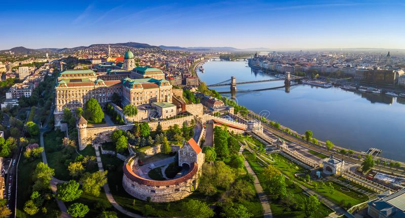 Budapest, Hungary - Aerial panoramic skyline view of Buda Castle Royal Palace with Szechenyi Chain Bridge. St. Stephen`s Basilica, Hungarian Parliament and stock images