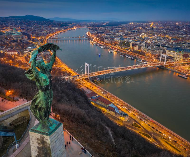 Budapest, Hungary - Aerial panoramic view of Budapest from above, with Statue of Liberty, Elisabeth and Szecheni Chain Bridge. And sightseeing boat on River royalty free stock photo