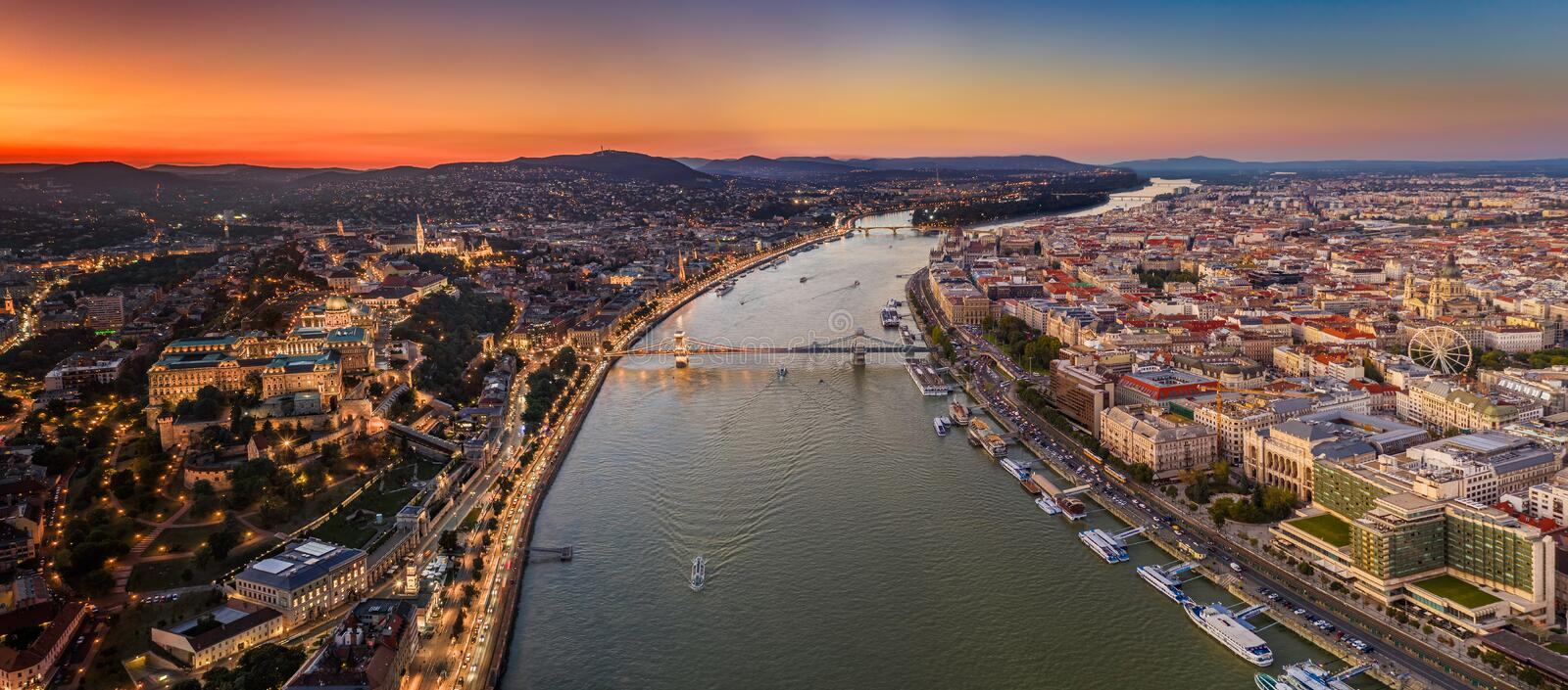 Budapest, Hungary - Aerial panoramic view of Budapest with Szechenyi Chain Bridge, Buda Castle Royal Palace. And St.Stephen`s Basilica. Time blending: Pest side royalty free stock images