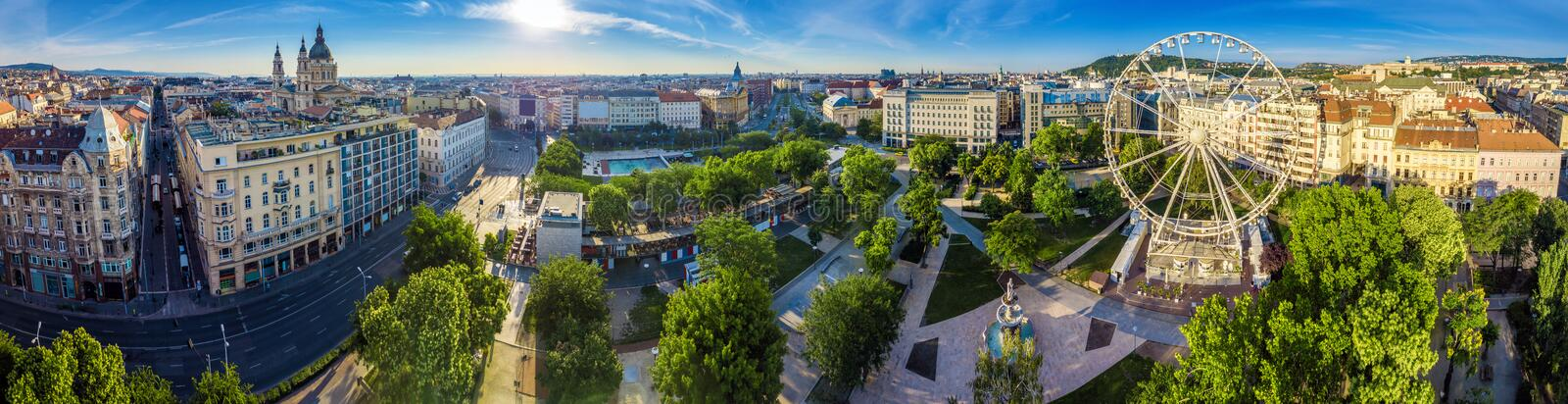 Budapest, Hungary - Aerial panoramic view of Elisabeth square Erzsebet ter at sunrise. This view includes St.Stephen`s Basilica, Deak Square, Parliament, Buda stock photo