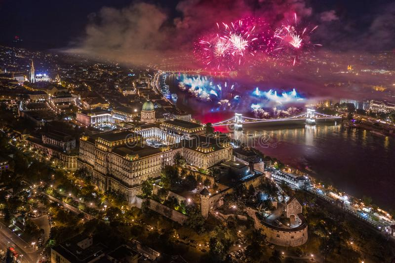 Budapest, Hungary - Aerial panoramic view of the illuminated Buda Castle Royal Palace and Szechenyi Chain Bridge with fireworks. Budapest, Hungary - Aerial stock photos