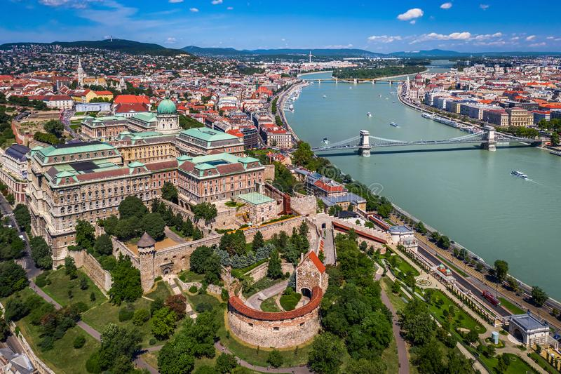 Budapest, Hungary - Aerial skyline view of Buda Castle Royal Palace on a bright summer day with Szechenyi Chain Bridge. River Danube and Parliament of Hungary royalty free stock images