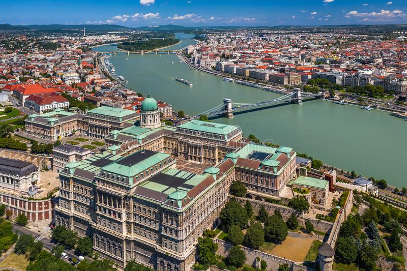 Budapest, Hungary - Aerial skyline view of Buda Castle Royal Palace on a bright summer day with Szechenyi Chain Bridge. River Danube and Parliament of Hungary stock image