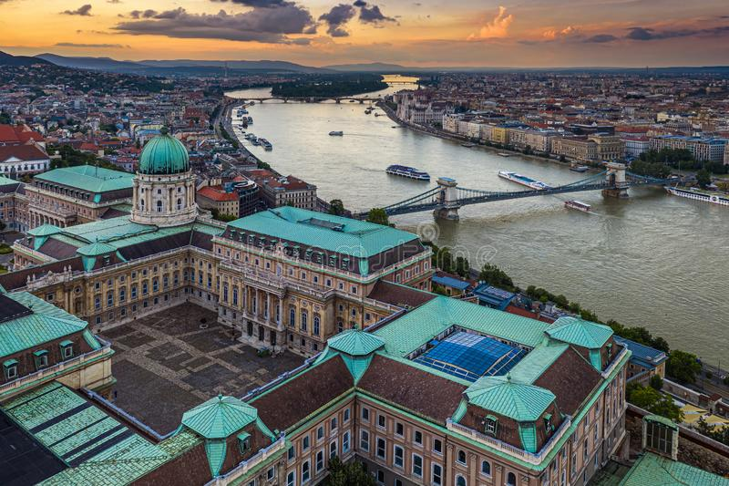 Budapest, Hungary - Aerial skyline view of Buda Castle Royal Palace with Szechenyi Chain Bridge and Parliament building. With a beautiful golden sunset at stock photos