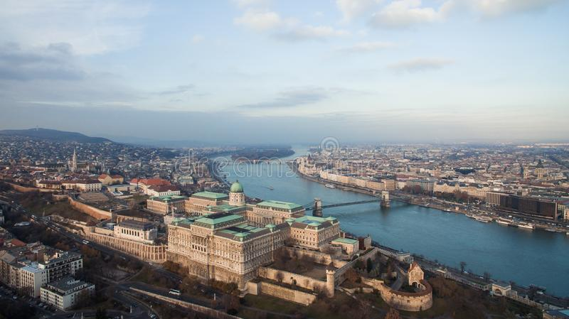 Budapest, Hungary - Aerial skyline view of Buda Castle with Szechenyi Chain Bridge and Danube River. Drone over Budapest. royalty free stock photo