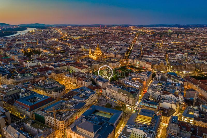Budapest, Hungary - Aerial skyline view of city centre of Budapest with Elisabeth Square, ferris wheel and St. Stephen`s Basilica. With clear blue and orange royalty free stock image