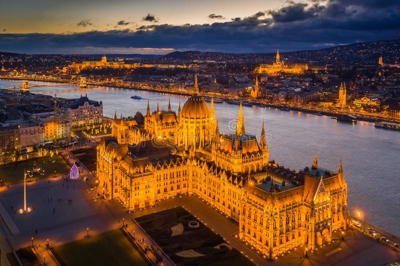 Budapest, Hungary - Aerial view of the beautiful illuminated Parliament of Hungary at dusk with Szechenyi Chain Bridge. Fisherman`s Bastion and other famous royalty free stock photography