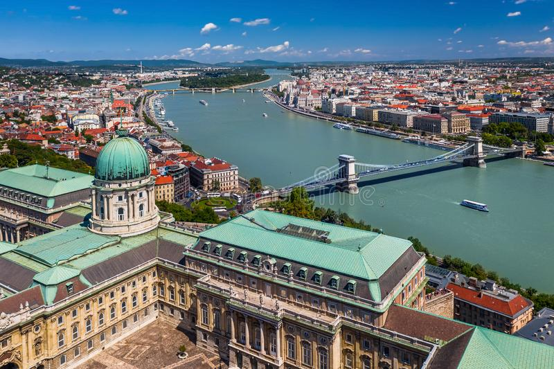 Budapest, Hungary - Aerial view of Buda Castle Royal Palace on a bright summer day with Szechenyi Chain Bridge, River Danube. And Parliament of Hungary at stock image