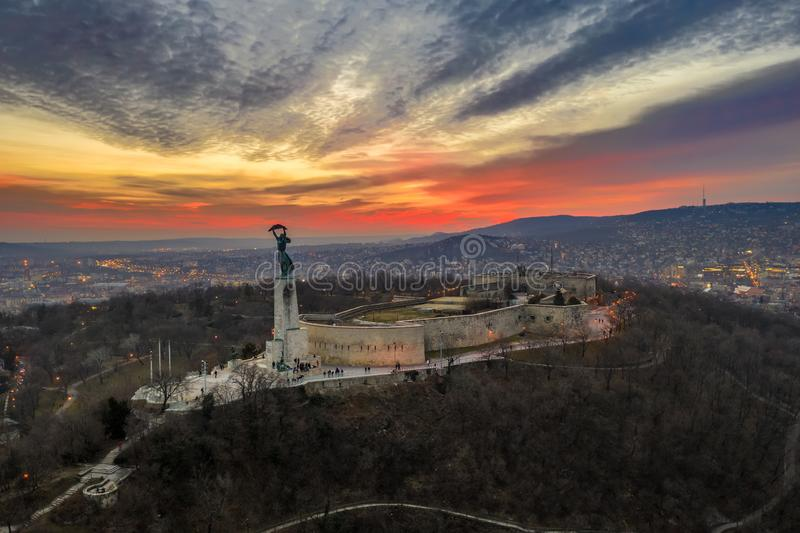 Budapest, Hungary - Aerial view of Gellert Hill, Citadel and Statue of Liberty with a fantastic colorful sunset. At winter time stock photography